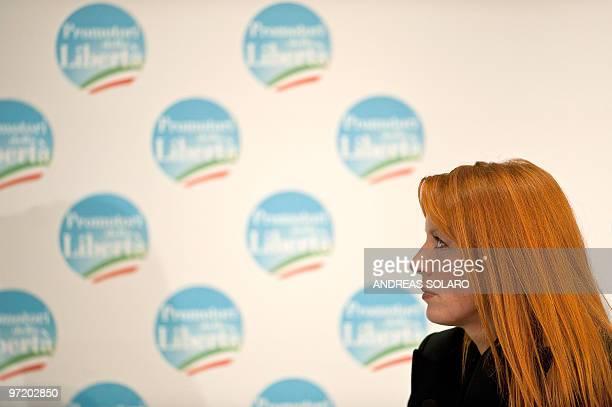 Italian Tourism minister Michela Vittoria Brambilla looks at Italian Prime Minister Silvio Berlusconi during a meeting to promote a candidates for...