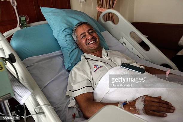 Italian tourist Andrea Tazzioli who was injured during the bomb attack in Salakam road smiles for a photograph on his bed at Sanpaulo hospital on...