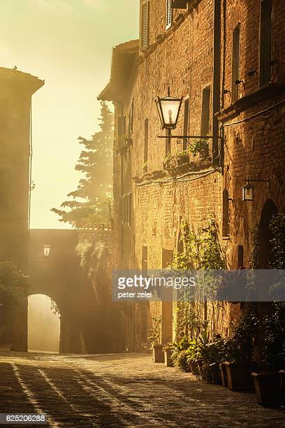 italian town of pienza at sunrise, tuscany - siena italy stock photos and pictures