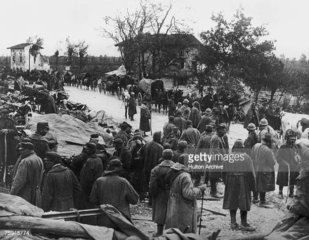 Italian troops retreat along the UdineCodroipo Road in northeast Italy after being soundly defeated by AustroHungarian and German forces at Caporetto...