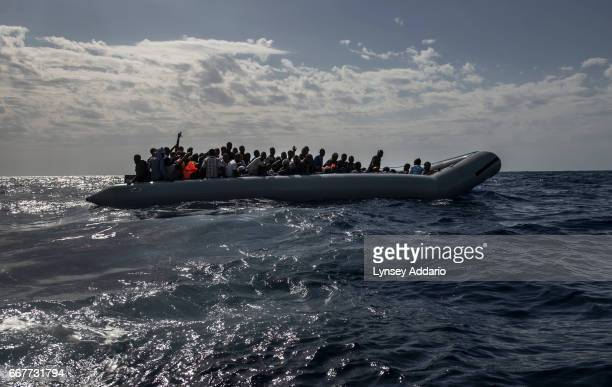 Italian troops with the Uraniam Navy Ship rescue African migrants from Gambia Mali Senegal Ivory Coast Guinea and Nigeria from a rubber boat in the...