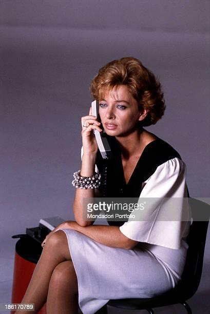 Italian TV and radio presenter Enrica Bonaccorti speaking over the phone in the TV show Pronto chi gioca Italy 1985