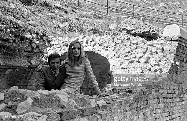 Italian TV and radio presenter Mike Bongiorno and his partner the Italian journalist and art director Annarita Torsello relaxing at the Ancient...