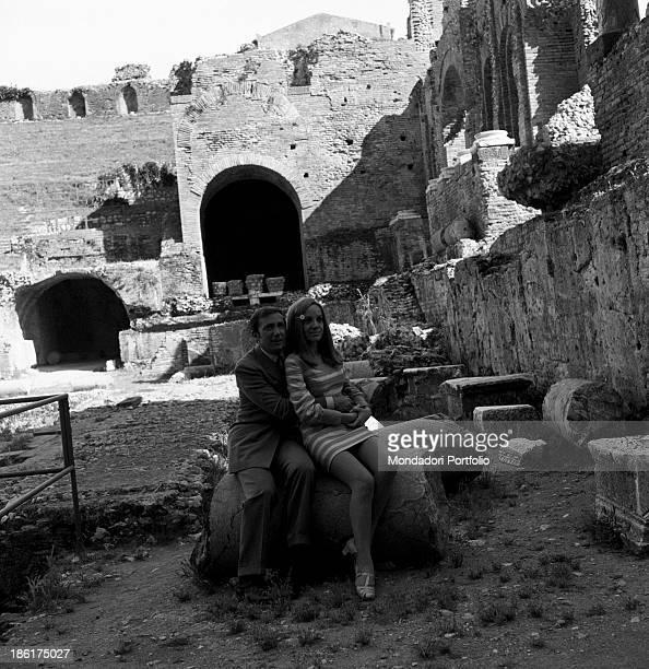 Italian TV and radio presenter Mike Bongiorno hugging his partner the Italian journalist and art director Annarita Torsello at the Ancient Theatre...