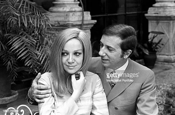 Italian TV and radio presenter Mike Bongiorno hugging his partner the Italian journalist and art director Annarita Torsello Taormina May 1967