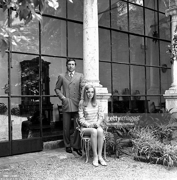 Italian TV and radio presenter Mike Bongiorno keeping his hand on the shoulder of his partner the Italian journalist and art director Annarita...