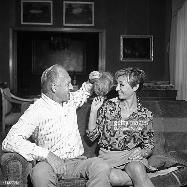 Italian TV artist Raimondo Vianello holding his wife Sandra Mondaini's wig 1967