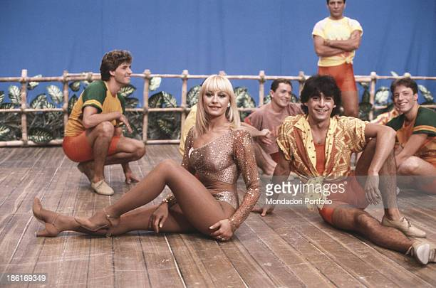 Italian TV host actress singer and showgirl Raffaella Carrà dancing with some dancers in the TV variety show Ma che sera Italy 1986