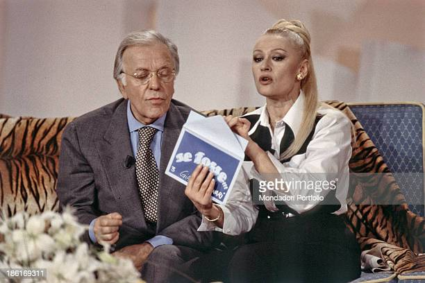 Italian TV host actress singer and showgirl Raffaella Carrà talking to Italian TV host and commentator Gianfranco Funari in the TV show 40 minuti con...