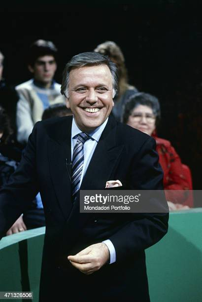 Italian TV host and commentator Gianfranco Funari smiling in an episode of the show Mezzogiorno Çù Italy 1987