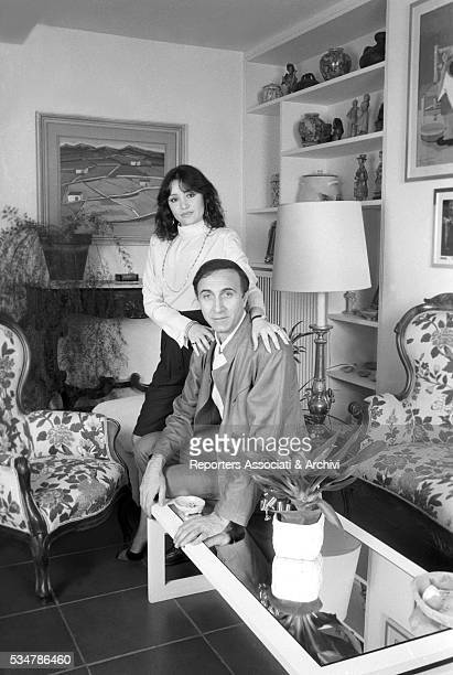 Italian TV host Pippo Baudo and his partner and Italian actress Adriana Russo at home 1981