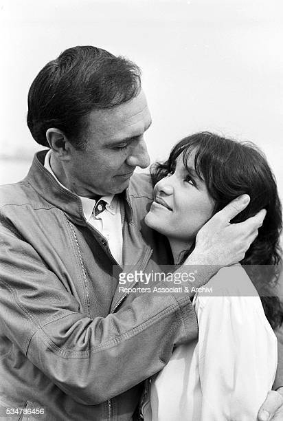 Italian TV host Pippo Baudo and his partner and Italian actress Adriana Russo looking into each other eyes 1981
