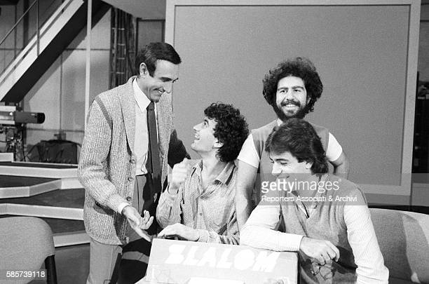 Italian TV host Pippo Baudo joking with comedy trio 'La Smorfia' during the reharsals of TV show Luna Park In the picture from the right Pippo Baudo...