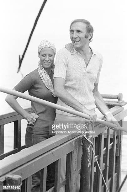 Italian TV host Pippo Baudo on holiday with his first wife Angela Lippi on a Roman coast beach In the picture the couple posing smiling on a jetty...