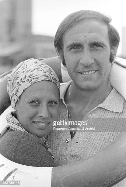 Italian TV host Pippo Baudo on holiday with his first wife Angela Lippi on a Roman coast beach In the picture the couple hugging with a life...