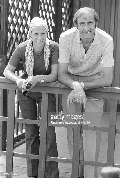 Italian TV host Pippo Baudo on holiday with his first wife Angela Lippi on a Roman coast beach In the picture the couple posing and smiling Fiumicino...
