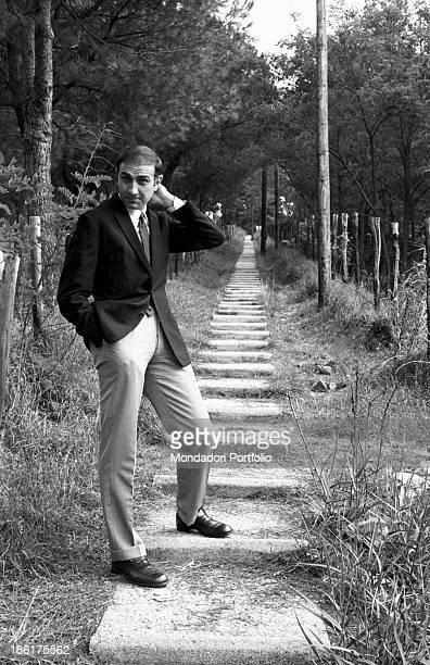 Italian TV host Pippo Baudo posing in a pine forest 1967