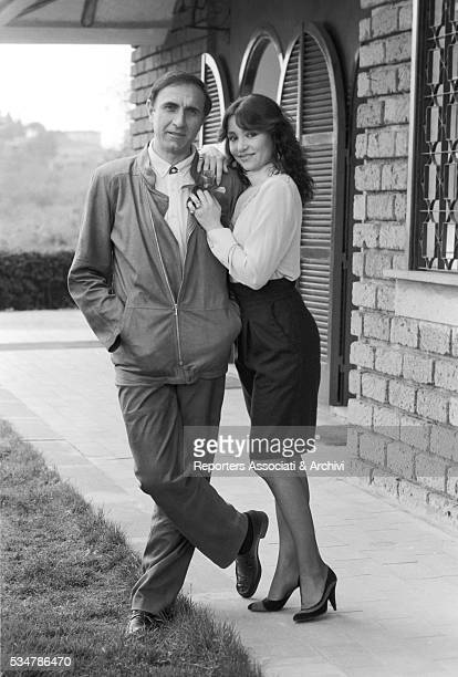 Italian TV host Pippo Baudo posing with his partner and Italian actress Adriana Russo at home 1981