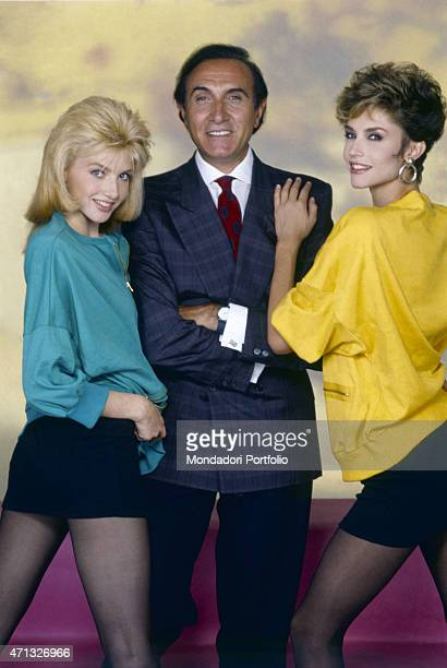 Italian TV host Pippo Baudo posing with Italian showgirls Lorella Cuccarini and Alessandra Martines The three artists present the TV variety show...