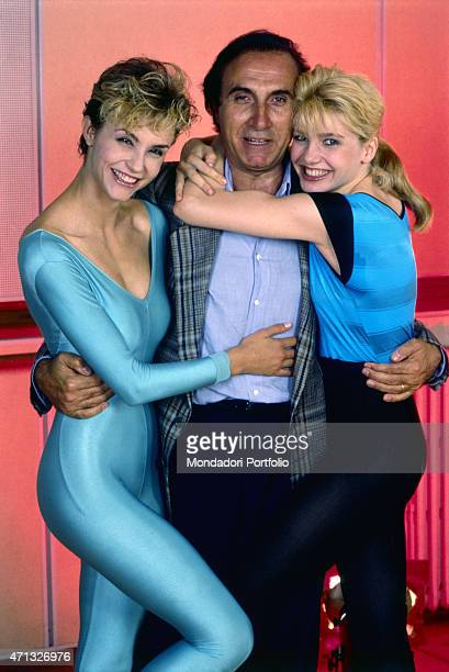 Italian TV host Pippo Baudo posing with Italian showgirls Lorella Cuccarini and Alessandra Martines. The three artists present the TV variety show...