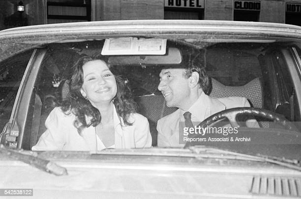 Italian TV host Pippo Baudo with Italian actress Adriana Russo his partner photographed in a car Italy 1974
