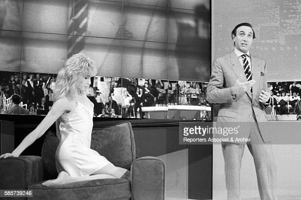 Italian TV host Pippo Baudo with Italian actress and showgirl Lorella Cuccarini during the shooting of TV show 'Festival' Italy 1987