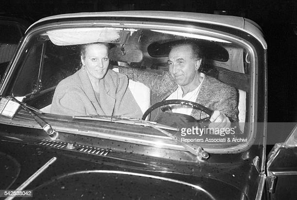 Italian TV host Pippo Baudo with Katia Ricciarelli , his fiancée and famous Italian soprano, photographed in a car. Italy, 1983