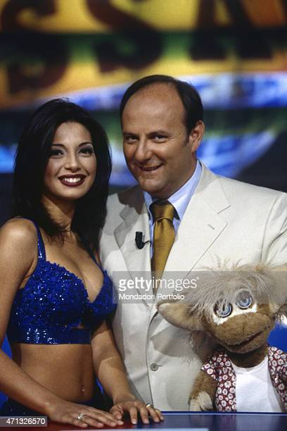 Italian TV presenter actor and disc jockey Gerry Scotti presenting the TV game show Passaparola in company of Italian showgirl and actress Alessia...