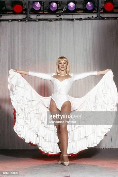 Italian TV presenter actress singer and showgirl Raffaella Carrà rehearsing a ballet using the maxi skirt of her dress The host will make soon her...