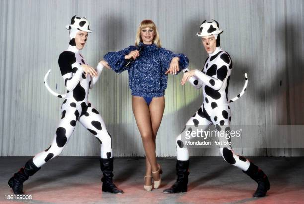 Italian TV presenter actress singer and showgirl Raffaella Carrà rehearsing a ballet with two dancers dressed as Dalmatian dogs The host will make...