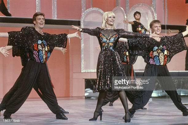 Italian TV presenter actress singer and showgirl Raffaella Carrà dancing with some dancers in the TV variety show Fantastico 3 Milan 1982