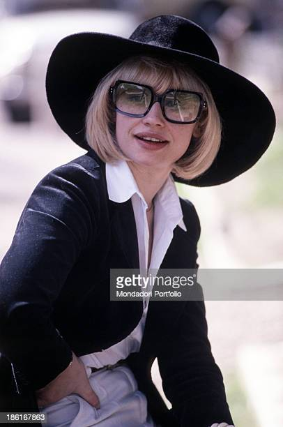 Italian TV presenter actress singer and showgirl Raffella Carrà wearing a pair of sunglasses and a widebrimmed hat 1978