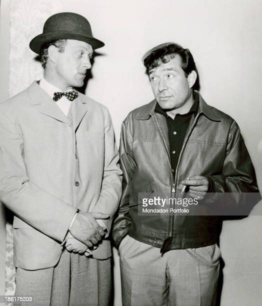 Italian TV presenter and actor Raimondo Vianello and Italian actor director and scriptwriter Ugo Tognazzi looking at each other into the eyes in a...