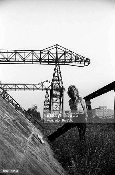 Italian TV presenter and actress Gabriella Farinon posing leaning her leg on a wall Italy 1968