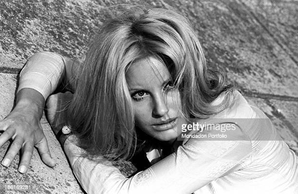 Italian TV presenter and actress Gabriella Farinon posing lying down Italy 1968