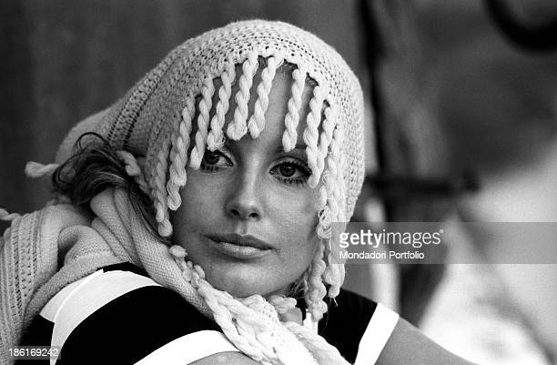 Italian TV presenter and actress Gabriella Farinon posing with a shawl on her head Italy 1968