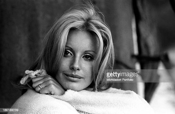 Italian TV presenter and actress Gabriella Farinon smiling wrapped up in a shawl Italy 1968