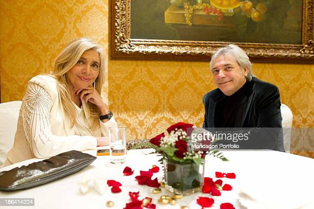 Italian TV presenter and actress Mara Venier sitting with Italian singersongwriter and actor Nino D'Angelo during the reception at the hotel Parco...