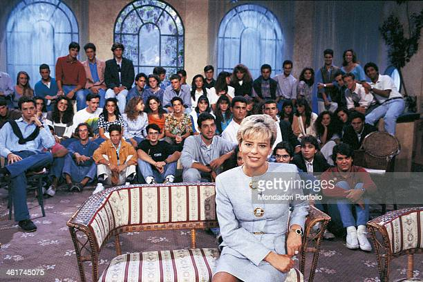 Italian TV presenter and author Maria De Filippi smiling sitting in the studio where the TV broadcast Amici is recorded The guys taking part in the...