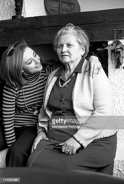 Italian TV presenter and showgirl Raffaella Carrà sitting beside her grandmother Andreina Bellaria 1970