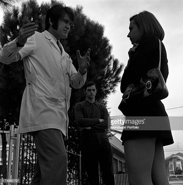 Italian TV presenter and showgirl Raffaella Carrà talking to a man Italy 1970