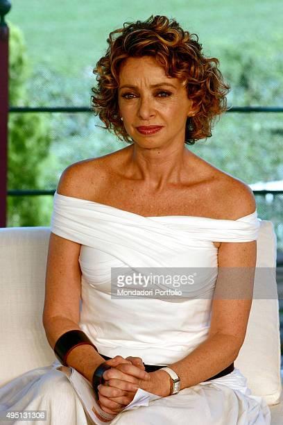 Italian Tv presenter Enrica Bonaccorti posing in a white dress for a photo shooting shooted in the TV studio of the show 'Il mio migliore amico'...