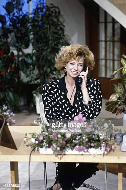 Italian TV presenter Enrica Bonaccorti speaking over the phone in the TV variety show Pronto chi gioca 1987