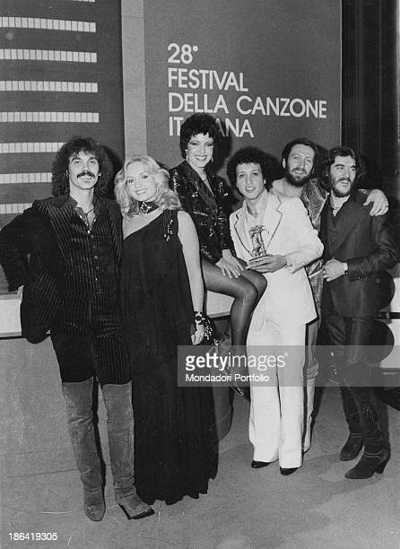Italian TV presenter Maria Giovanna Elmi smiling with the members of Italian band Matia Bazar winners of 28th Sanremo Music Festival with the song E...