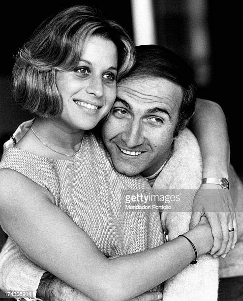Italian TV presenter Pippo Baudo and his wife Angela Lippi hugging each other Milan 1970