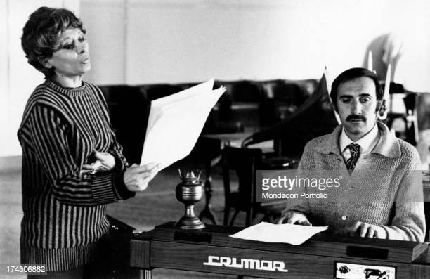 Italian TV presenter Pippo Baudo and Italian actress and TV presenter Sandra Mondaini rehearsing a song of the theatre comedy L'Ora della Fantasia...