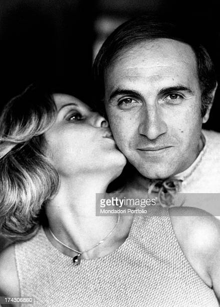 Italian TV presenter Pippo Baudo being kissed on his cheek by his wife Angela Lippi Milan 1970