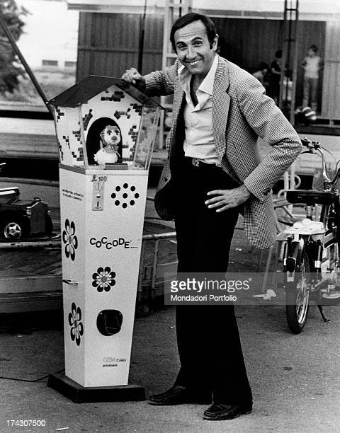 Italian TV presenter Pippo Baudo having fun and leaning on a a game called Cocodè. Rome, 1973.