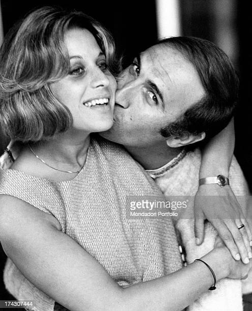 Italian TV presenter Pippo Baudo kissing his wife Angela Lippi Milan 1970