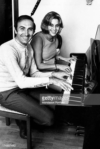 Italian TV presenter Pippo Baudo playing the piano with his wife Angela Lippi Milan 1970